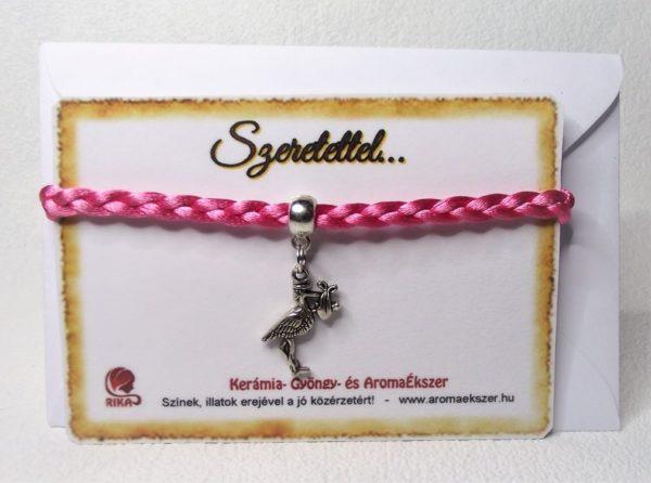 Babaváró karkötő -Fonatos rózsaszín szaténzsinóros karkötő gólya medállal - www.aromaekszer.hu